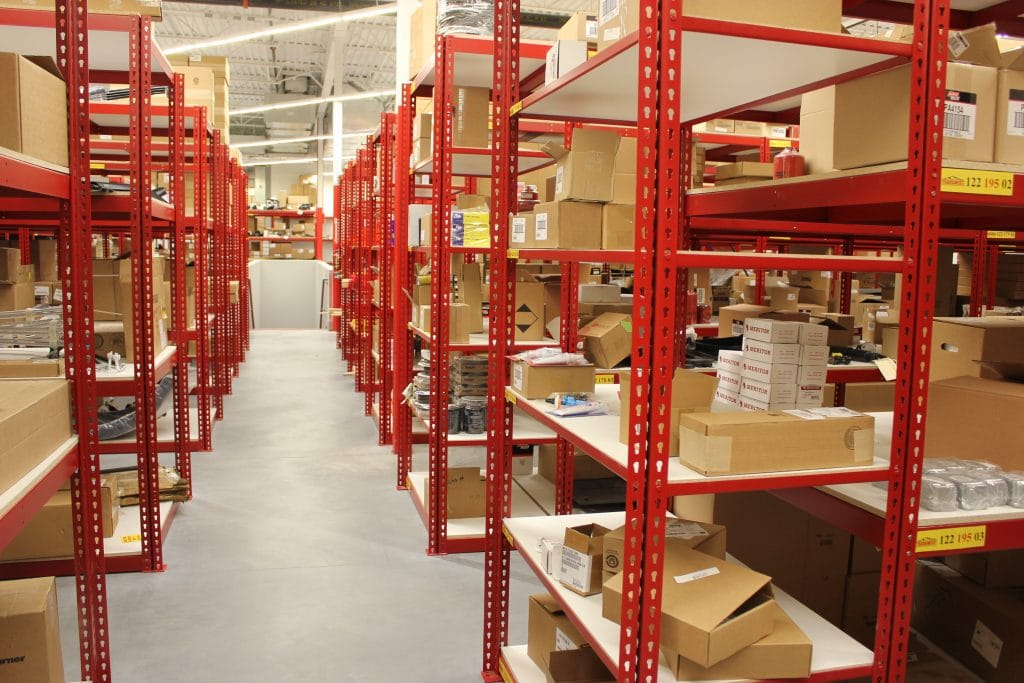 Teilhaber Custom Shelving storing merchandise with side angle